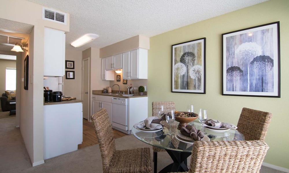 Bright dining room accent wall at 2111 Holly Hall in Houston, Texas