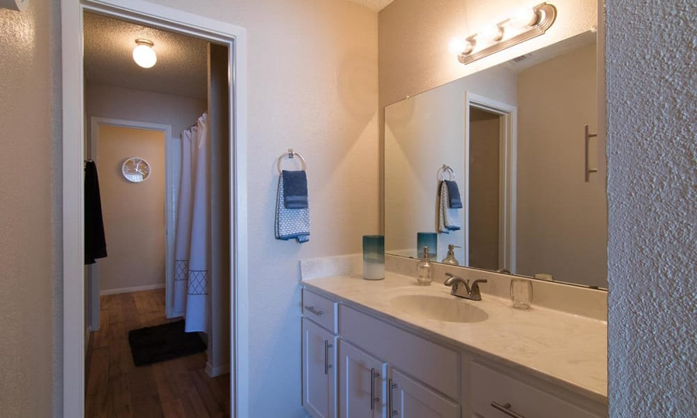 Bathroom with hardwood floors at 2111 Holly Hall in Houston, Texas