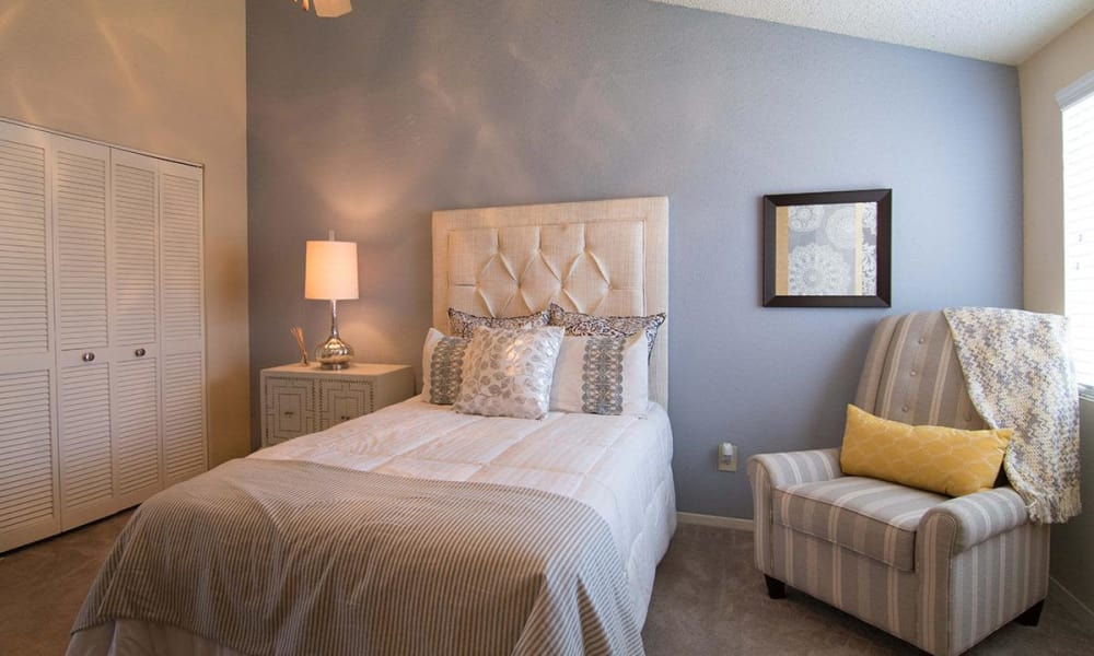 Beautiful twin bed at 2111 Holly Hall in Houston, Texas