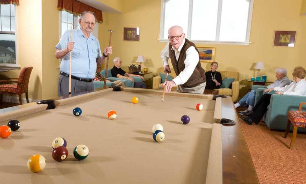Residents of Traditions of Hershey playing pool in Palmyra, Pennsylvania
