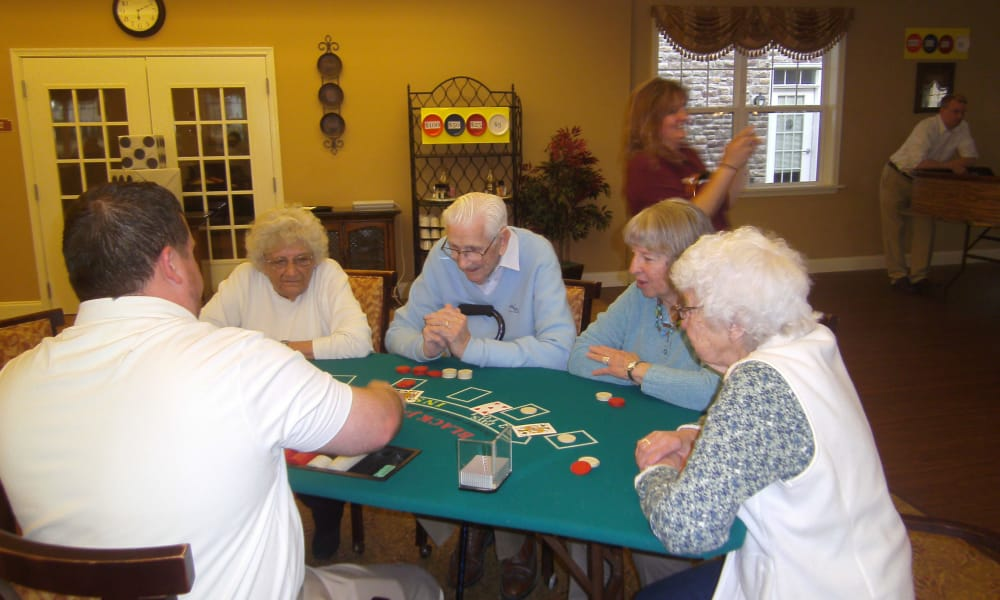 Residents playing poker at Traditions of Hershey in Palmyra, Pennsylvania