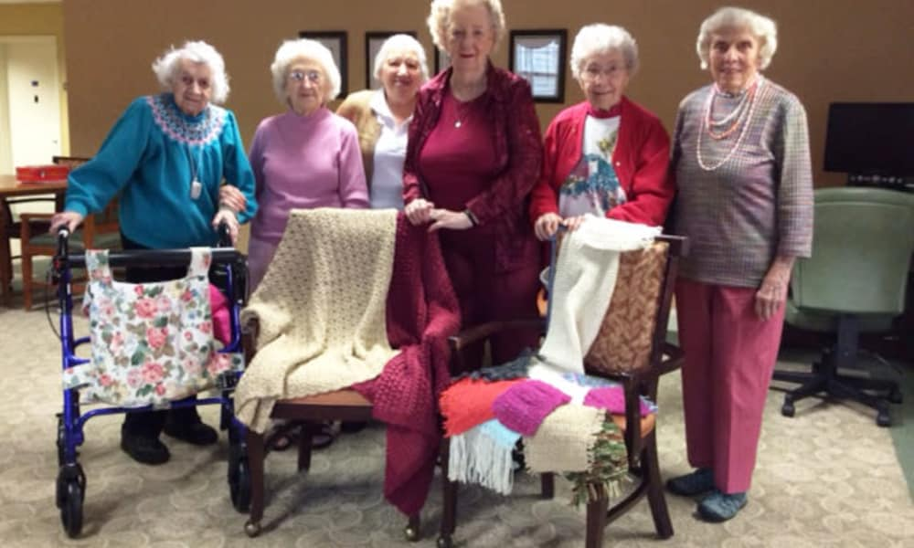 Residents making quilts at Traditions of Hershey in Palmyra, Pennsylvania