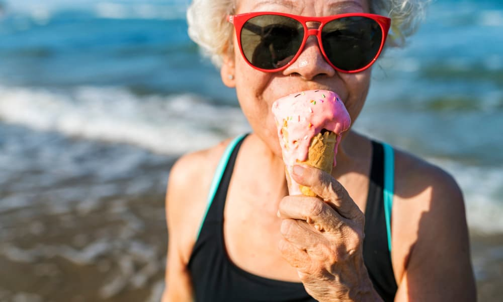 Senior woman at the beach with ice cream Hale O Meleana in Honolulu, Hawaii