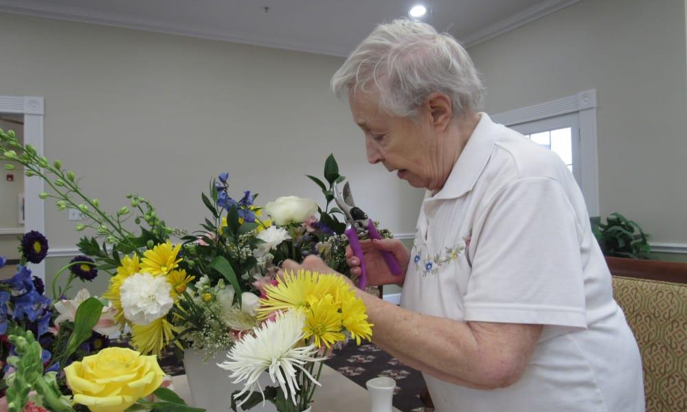 senior resident creating flower arrangements