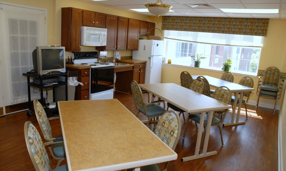 A community kitchen with dining room seating at Chestnut Knoll in Boyertown, Pennsylvania