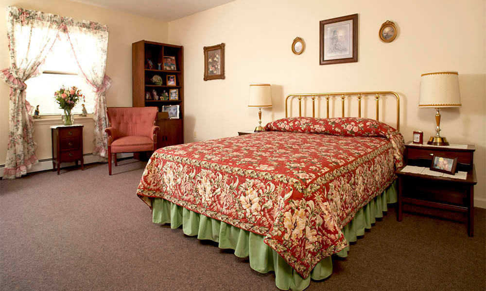 Large bed in the living spaces at Heritage Hill Senior Community in Weatherly, Pennsylvania