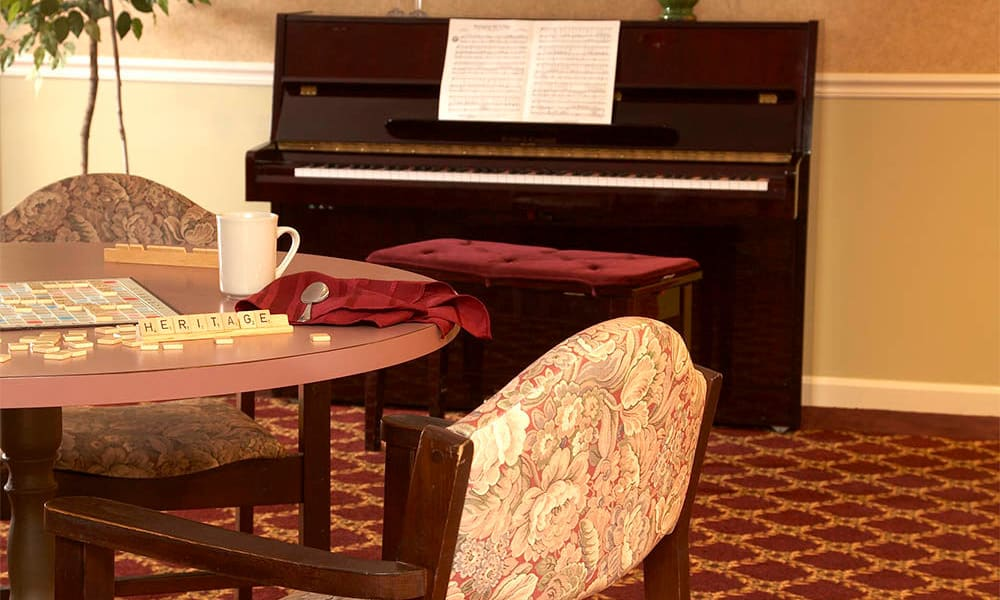 Game room with a piano at Heritage Hill Senior Community in Weatherly, Pennsylvania