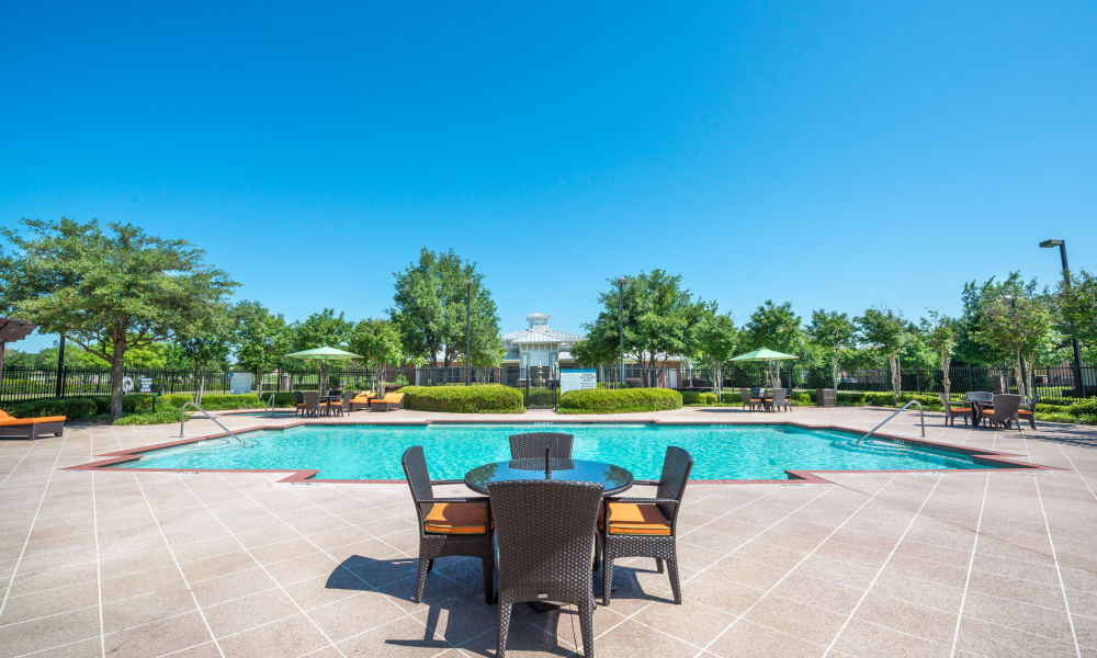 Luxury swimming pool with deck at The Atlantic Station in Fort Worth, Texas
