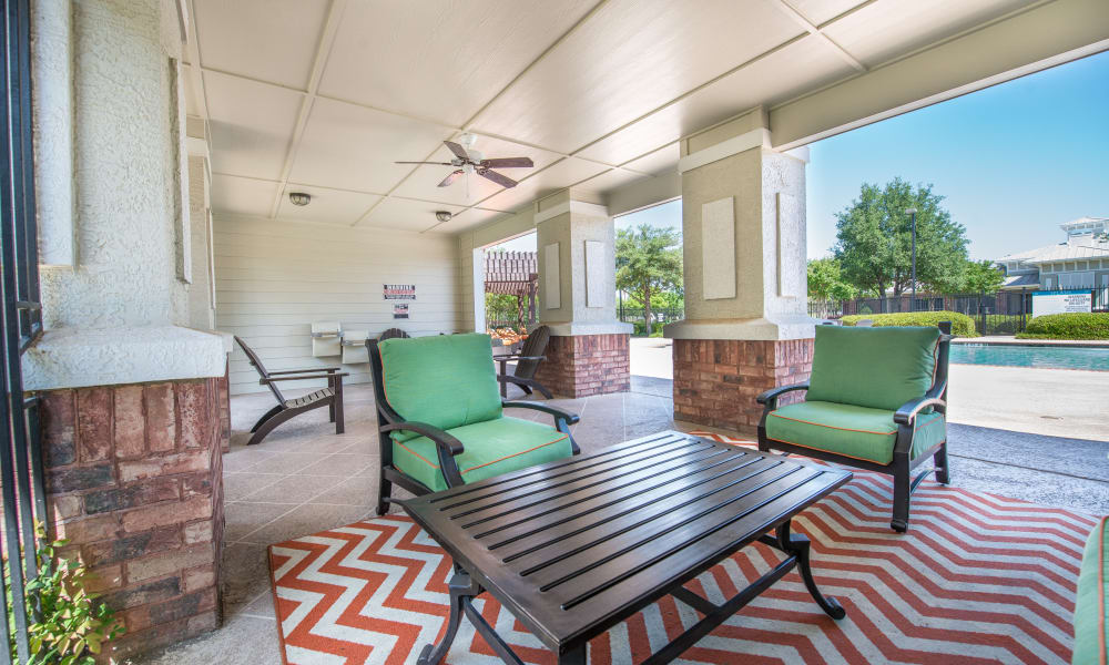 Outdoor covered patio with comfortable seating at The Atlantic Station in Fort Worth, Texas