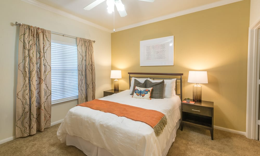 Large master bedroom with window at The Atlantic Station in Fort Worth, Texas