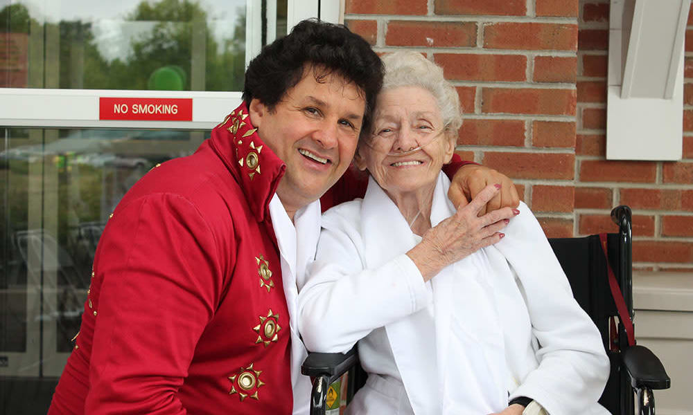 Elvis impersonator and a resident posing for a photo at The Birches at Harleysville in Harleysville, Pennsylvania