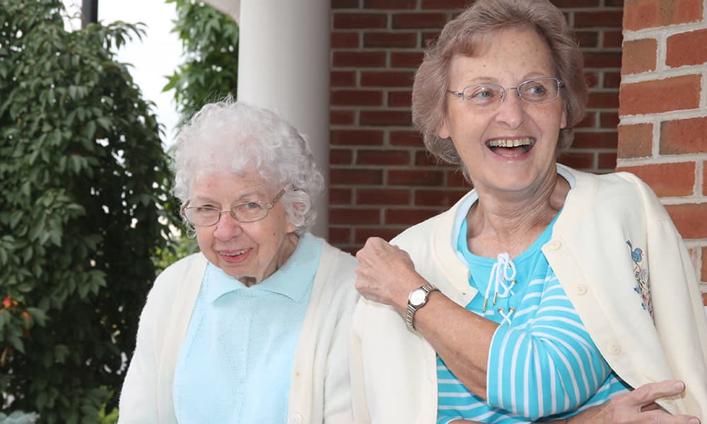 Two residents posing for a photo at The Birches at Harleysville in Harleysville, Pennsylvania