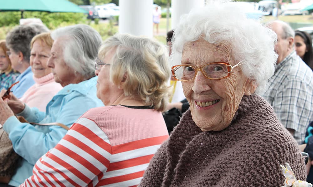 Resident attending an event looking at the camera at The Birches at Harleysville in Harleysville, Pennsylvania