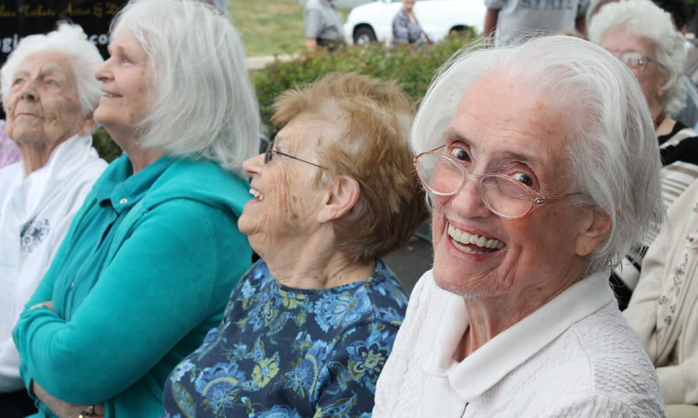 Resident from The Birches at Harleysville looking into the camera from a crowd in Harleysville, Pennsylvania