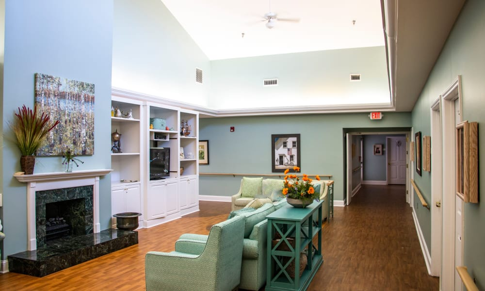 lounge living area with fireplace and television at Preston House in Charlotte