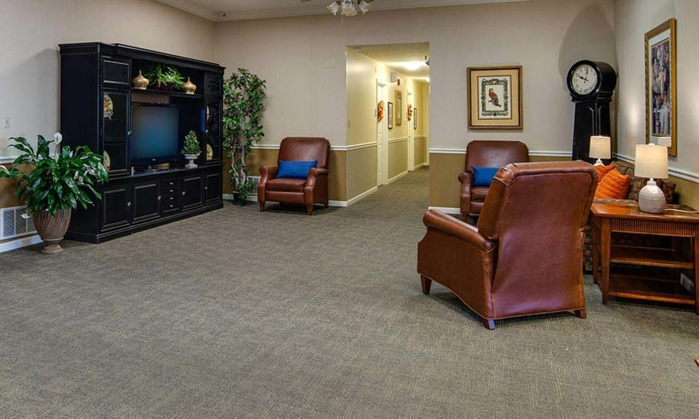 Memory care living space TV lounge at The Arbors at WestRidge Place Senior Living in Sikeston, Missouri