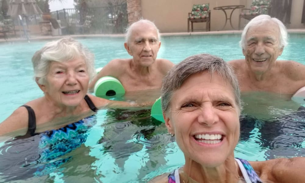 Happy residents in the community pool at Mulligan Park Gracious Retirement Living in Tallahassee, Florida