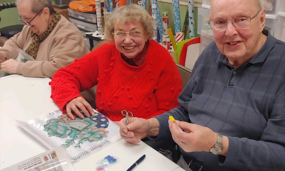 Senior man and woman doing a beading project at Cardinal Village in Sewell, New Jersey