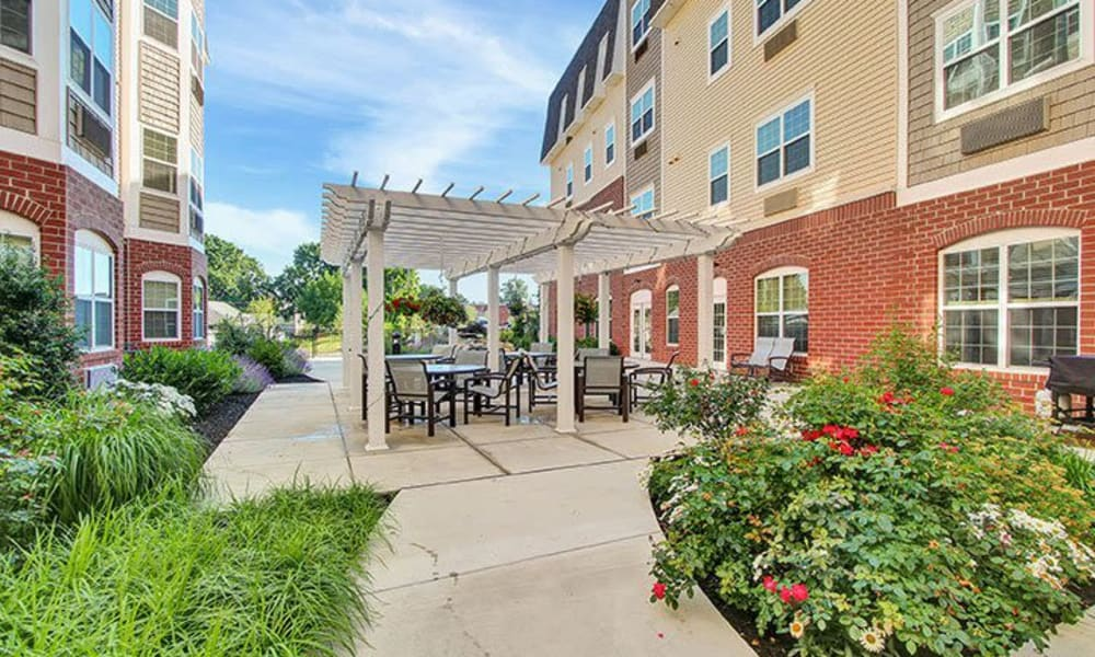 Beautifully landscaped courtyard at Keystone Villa at Ephrata in Ephrata, Pennsylvania