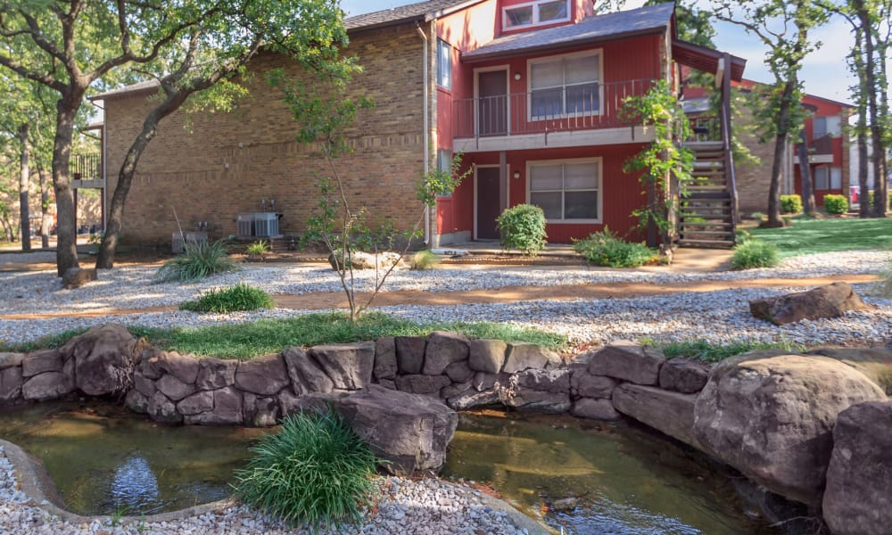 exterior with beautiful pond at The Summit at Landry Way in Fort Worth, TX