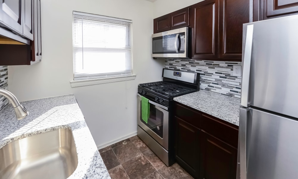 Fully-equipped kitchen at apartments in Elmwood Park, New Jersey