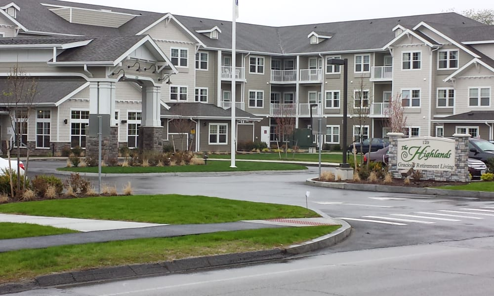 Building exterior and main entrance at The Highlands Gracious Retirement Living in Westborough, Massachusetts