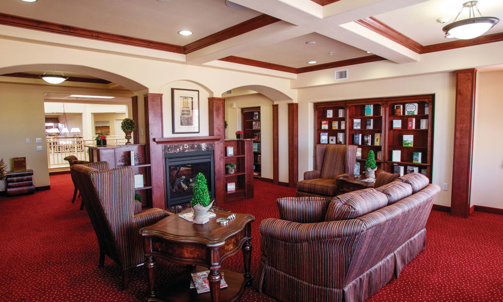 Fireside seating in the library at The Highlands Gracious Retirement Living in Westborough, Massachusetts