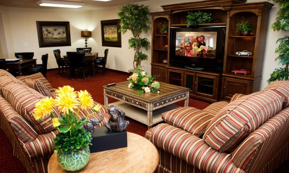 Cozy lounge seating in the entertainment room at The Highlands Gracious Retirement Living in Westborough, Massachusetts