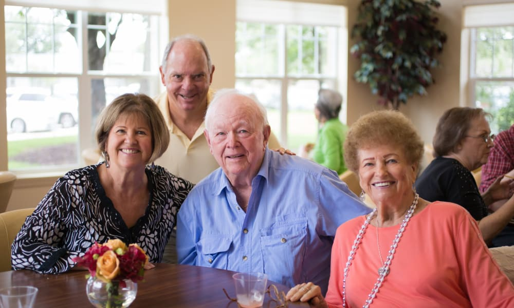 Residents gathered around a table at The Oaks Gracious Retirement Living in Georgetown, Texas