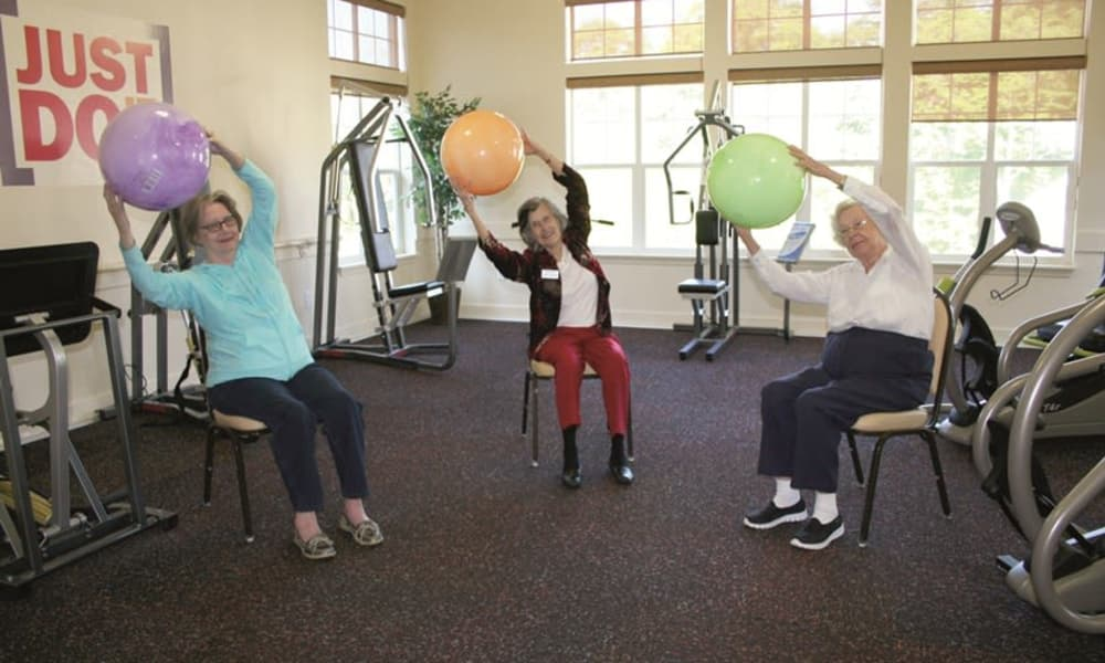 Residents exercising with exercise balls at The Oaks Gracious Retirement Living in Georgetown, Texas