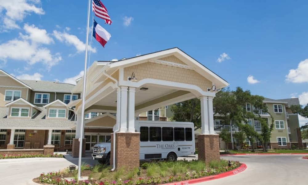 The community bus parked in front of The Oaks Gracious Retirement Living in Georgetown, Texas