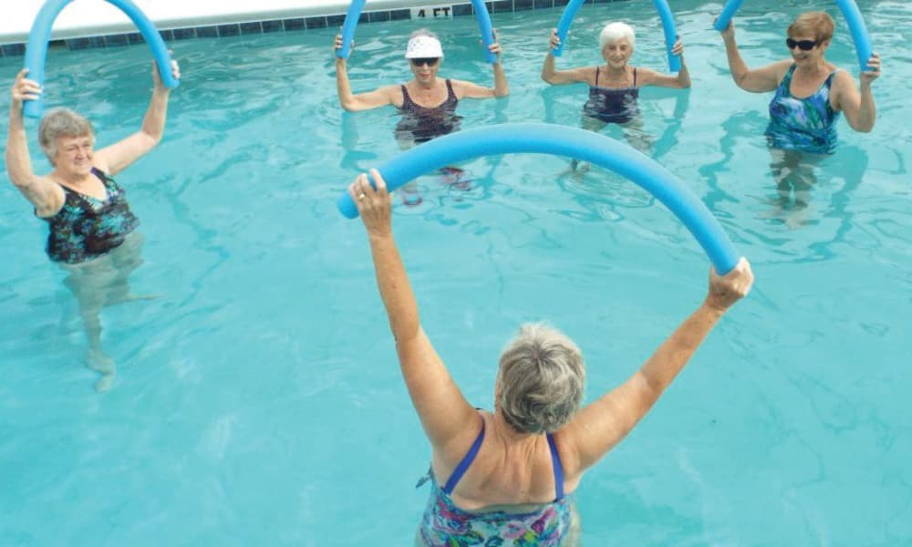 Residents exercising in the community pool at The Peaks at Santa Rita in Green Valley, Arizona