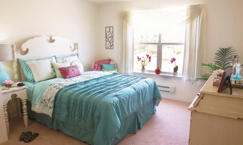 A sunny apartment bedroom at The Peaks at Santa Rita in Green Valley, Arizona