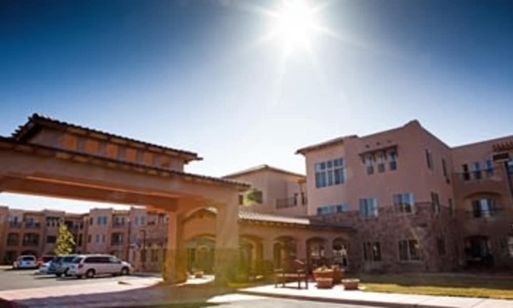 The building exterior and main entrance at The Rio Grande Gracious Retirement Living in Rio Rancho, New Mexico