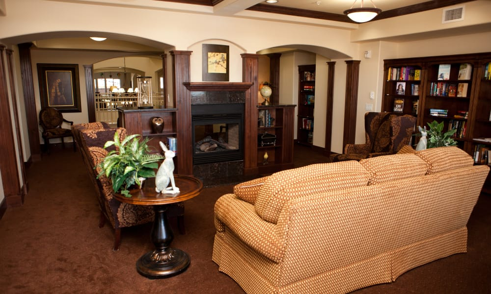Fireside seating in the library at The Rio Grande Gracious Retirement Living in Rio Rancho, New Mexico