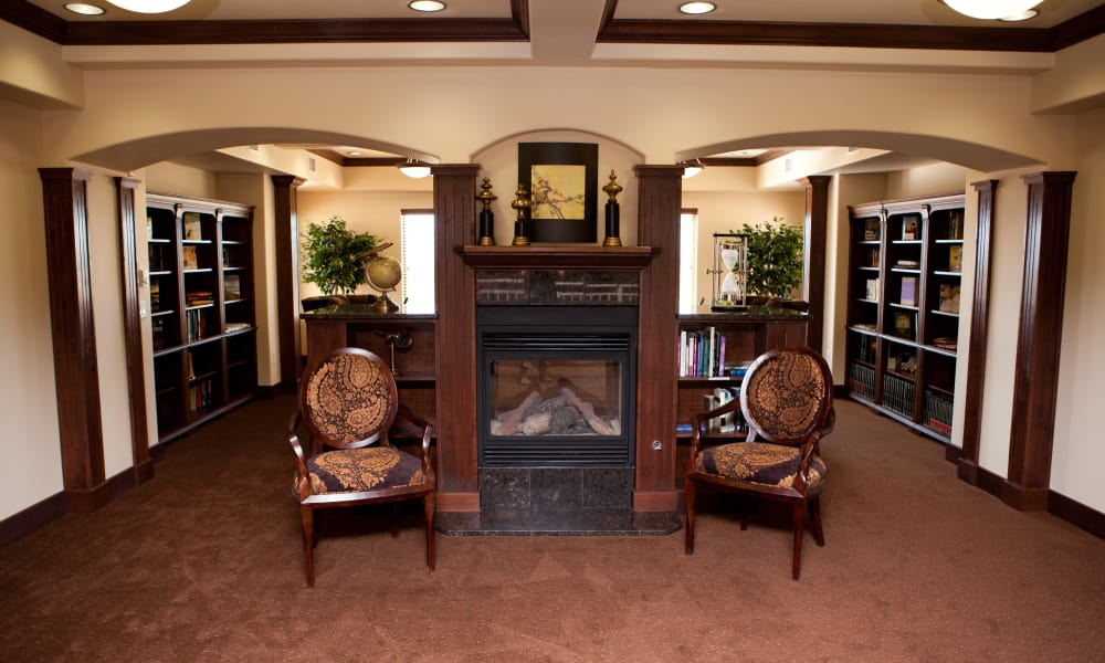 Cozy seating in the library at The Rio Grande Gracious Retirement Living in Rio Rancho, New Mexico