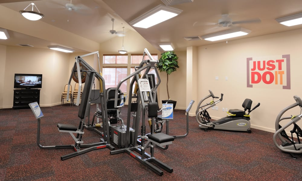 Exercise equipment in the gym at Whispering Pines Gracious Retirement Living in Raleigh, North Carolina