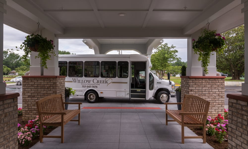 The community bus parked in front of Willow Creek Gracious Retirement Living in Chesapeake, Virginia