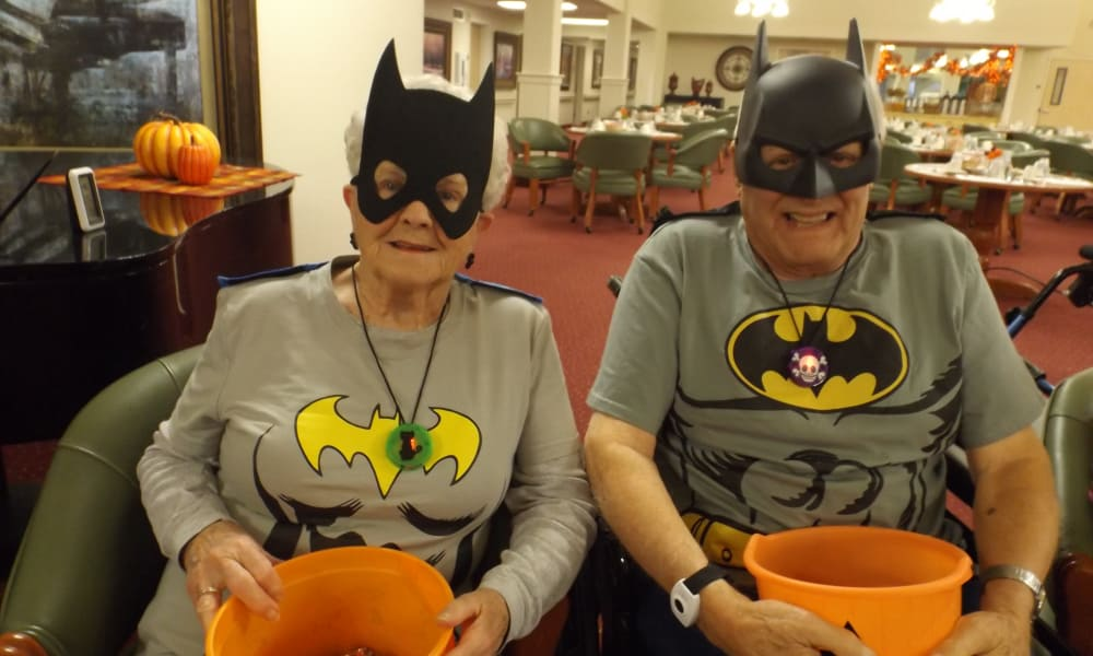 Two residents dressed up and handing out candy on Halloween at Mulberry Gardens Assisted Living in Munroe Falls, Ohio