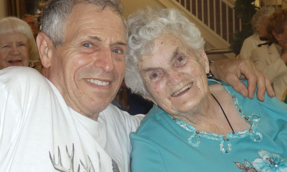 Two residents posing for a photo at Mulberry Gardens Memory Care in Munroe Falls, Ohio