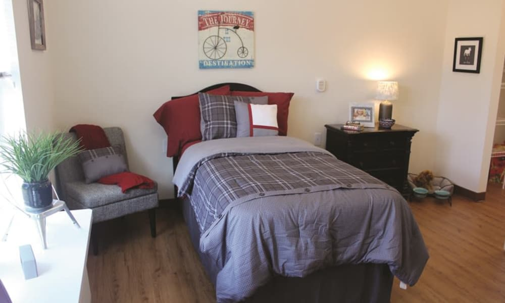 A well decorated bedroom at Mulberry Gardens Memory Care in Munroe Falls, Ohio