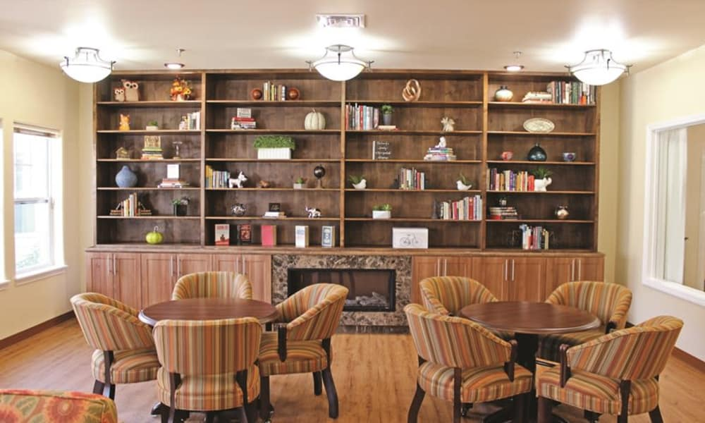 Fireside seating in the reading room at Mulberry Gardens Memory Care in Munroe Falls, Ohio