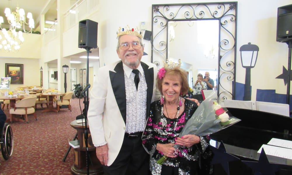 Prom king and queen posing for a photo at The Palms at Bonaventure Assisted Living and Memory Care in Ventura, California
