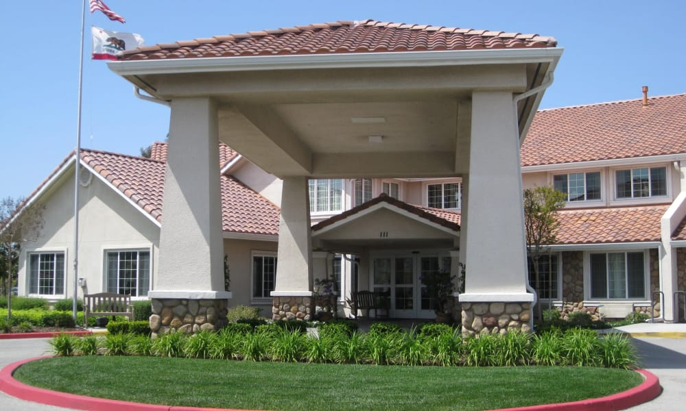 The building exterior and main entrance at Palms at Bonaventure Assisted Living in Ventura, California
