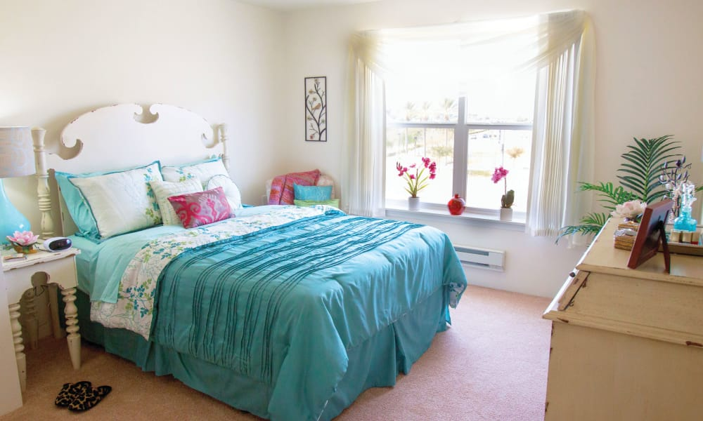 A well decorated bedroom at Palms at Bonaventure Assisted Living in Ventura, California