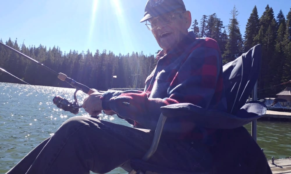 A resident from Stoneybrook Assisted Living in Corvallis, Oregon fishing off a dock