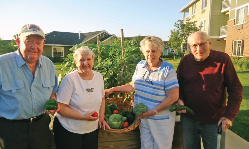 Residents harvesting form the community garden at Stoneybrook Assisted Living in Corvallis, Oregon