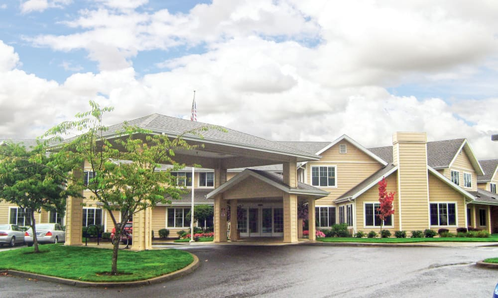 Building exterior and the main entrance at Stoneybrook Assisted Living in Corvallis, Oregon