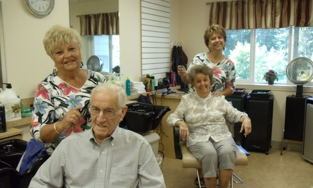 Two residents getting a haircut in the salon at Birchwoods at Canco Assisted Living in Portland, Maine