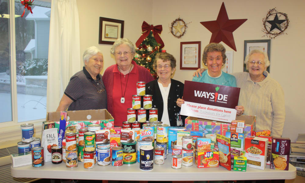 Residents with canned food donations for Wayside from Birchwoods at Canco Assisted Living in Portland, Maine